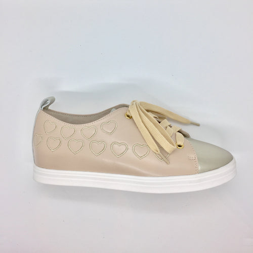 Beige and light gold lace ups with stitching detail and white rubber sole