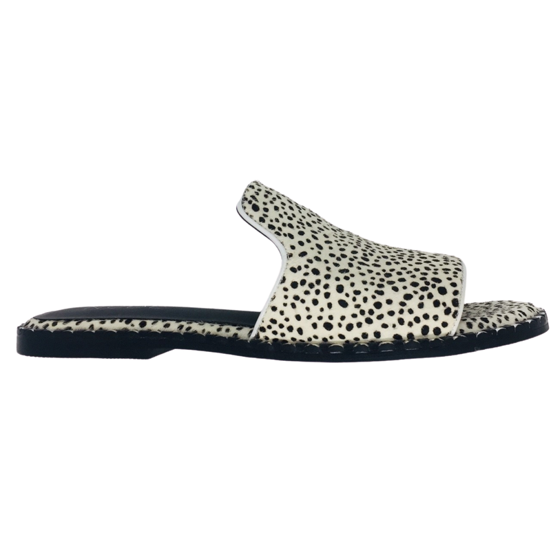 Suede pony hide slides in white with tiny black spots