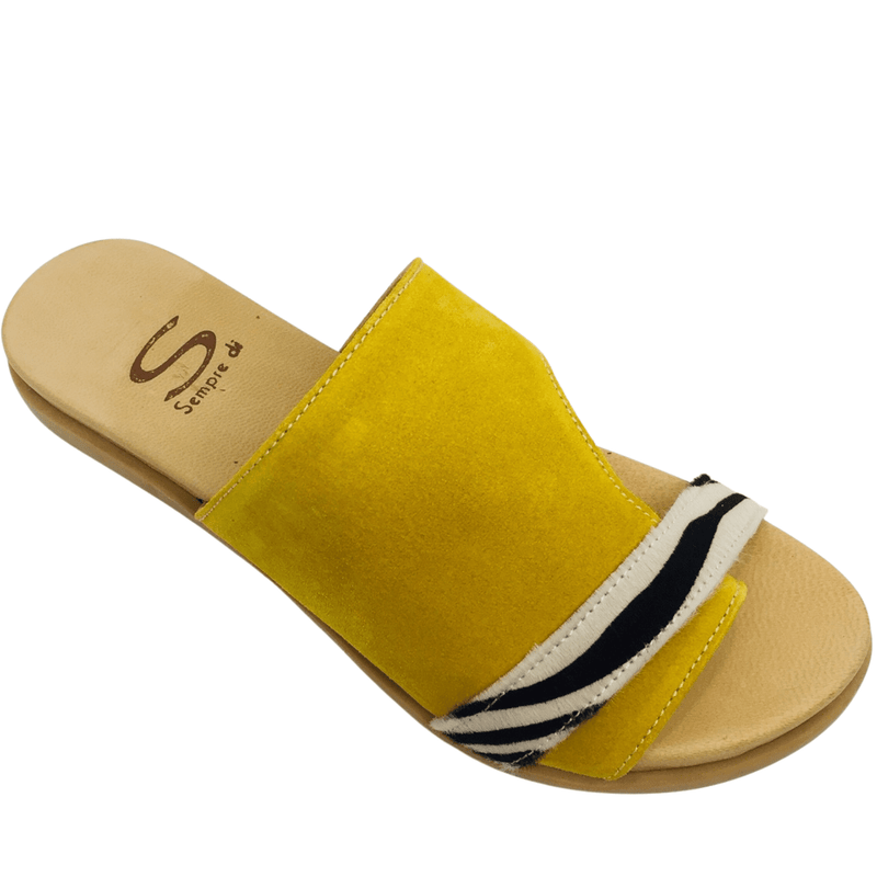 Comfortable foot bed, mustard suede with zebra pony hair strap across the toes and a toe piece thong.