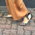 Suede zebra print flats with pointed toe and ankle tie