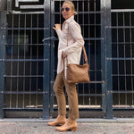 Tan leather boots with elastic sides, low square heel and pointed toe