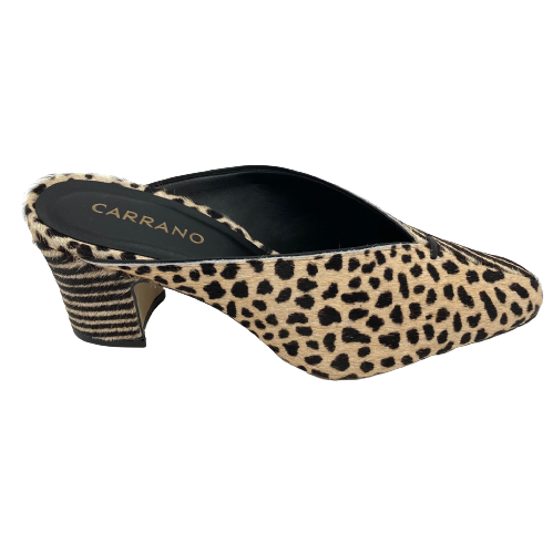 These unique little mules will look great with pants, skirts and dresses. With a heel measuring 7cm and a deep throated toe which comes back well at the sides of the foot this is a shoes you can look stylish in while being comfortable too. Made of hide (and leather lined of course) the combination of leopard and zebra prints makes it a shoe that will stand out from the rest.  Made in Brazil