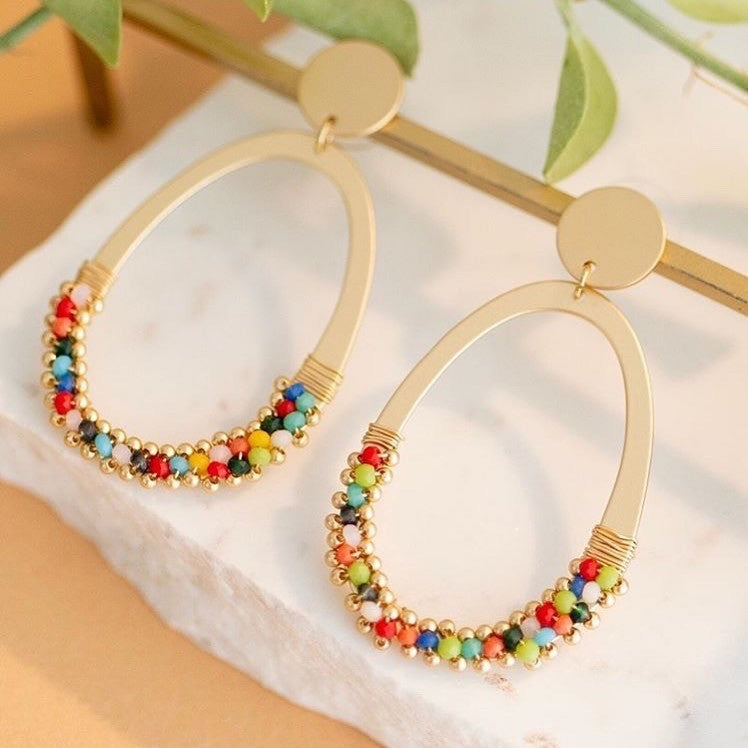 Matt gold earrings with a drop oval ring of multi coloured beads. Light to wear.