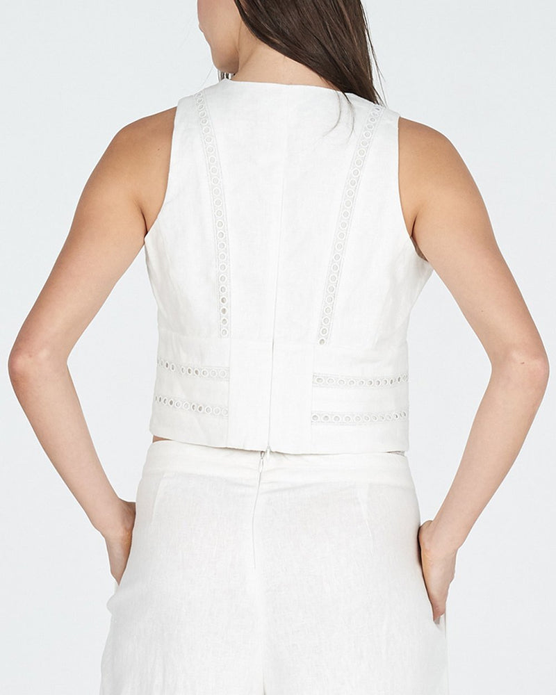 white linen top with circular lace motif, fitted, sleeveless with v-neck