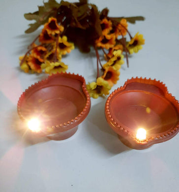 Eshwarshop Battery Operated Flameless Indian Diya Deepak Led Light (Brown) With Hand Shape Led- 2