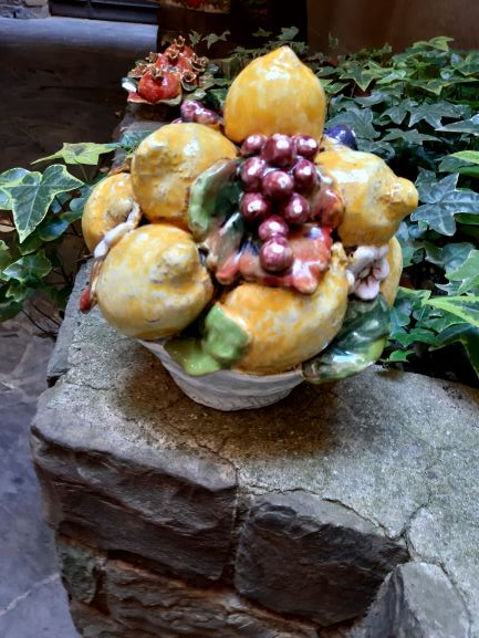 Tuscan centerpiece with lemons and grapes