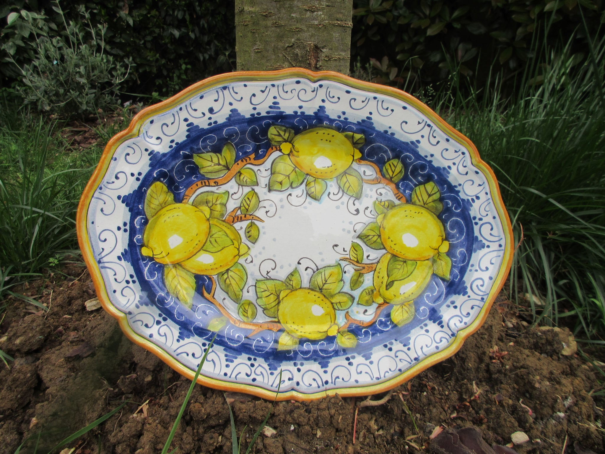 Tuscan platter handmade, hand painted with scalloped edge in the traditional lemons design