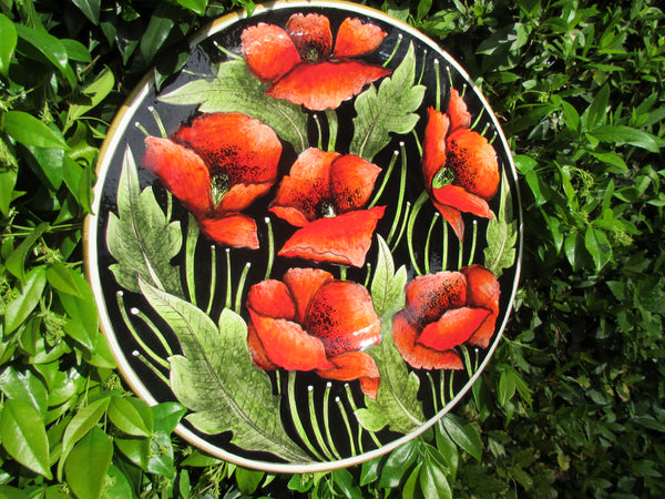 Tuscan round wall plate handmade, hand-painted with dark red poppies and green leaves
