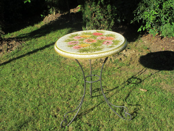 Tuscan round table with ceramic top and wrought iron base in anemone pattern