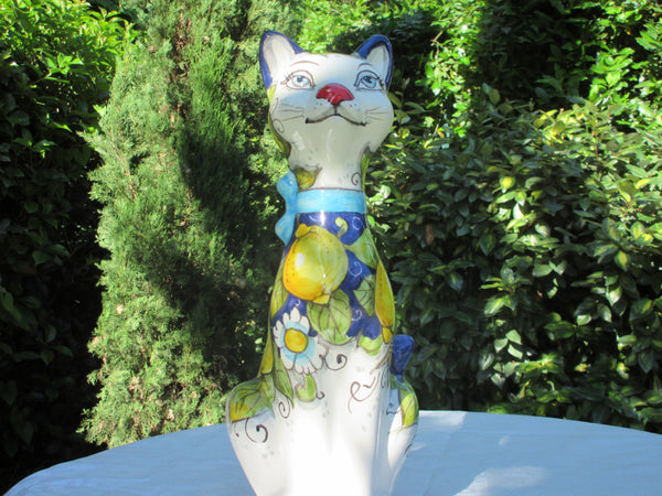 White ceramic cat handmade, hand-painted in yellow, blue with lemons and flowers