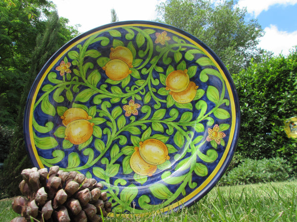 Tuscan round wall plate/centerpiece in lemons on blue background