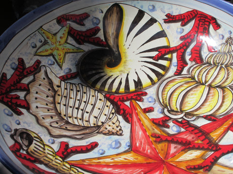 Tuscan round bowl with seafish,seashells design in orange , red colours