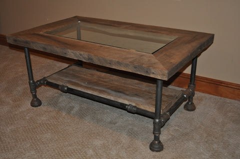 Industrial blackpipe and barnwood coffee table