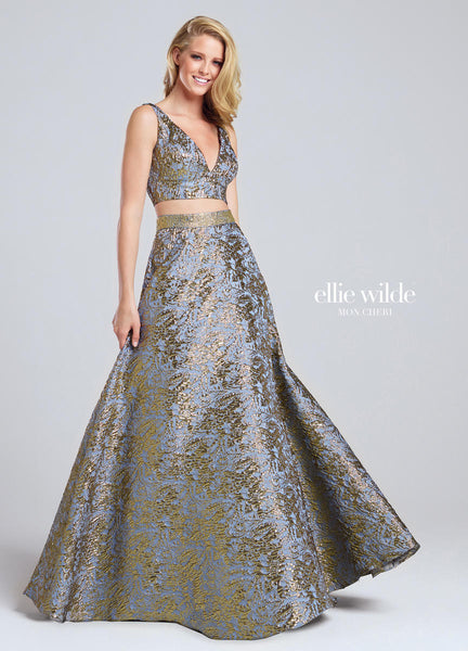 Two-piece metallic jacquard dress set, sleeveless cropped top with deep plunging front and back V-necklines, full A-line skirt with jeweled high waist.   Ellie Wilde by Mon Cheri