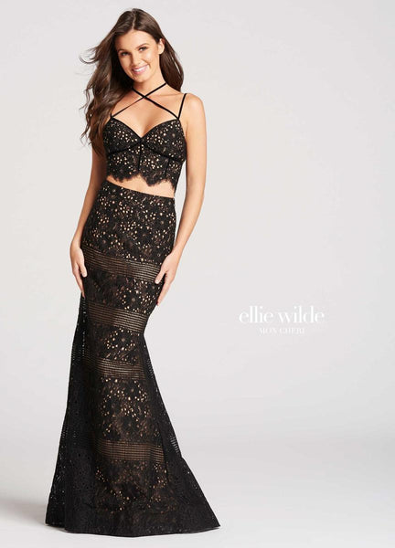 The fabric in this Ellie Wilde Two-Piece style is Lace   Ellie Wilde by Mon Cheri