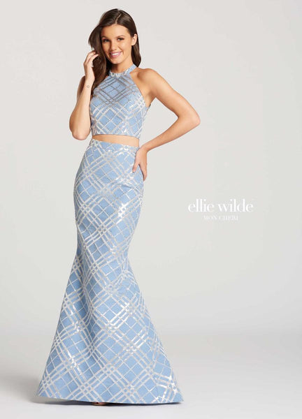 The fabric in this Ellie Wilde Two-Piece style is Jacquard   Ellie Wilde by Mon Cheri
