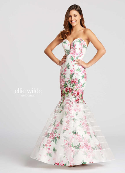 The fabric in this Ellie Wilde Exclusive Print style is Lace, Printed Mikado, & Tulle   Ellie Wilde by Mon Cheri