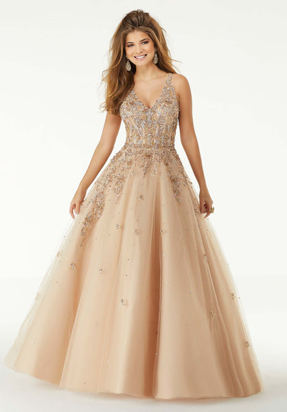A spine-framing cutout and a suspended V-neckline daringly detailed with a jewel glinted, encrusted bodice and embroidery on tulle, Morilee Dress 45023 is utterly beguiling and dramatic with a voluminous, fairytale-like skirt in Nude/Rose Gold. Prom Dresses 2020