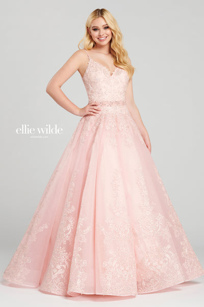 Sleeveless sparkle tulle and lace applique ball gown with a v-neck, drop waist with a beaded belt detail at the natural waist, open back, stone accents throughout, full skirt with a horsehair hem detail.  Prom 2020