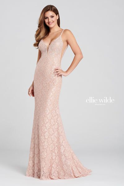 Sleeveless stretch lace sheath gown with a plunging v-neck, natural waist, sheer insets at the sides, scoop back, stone accent throughout and a sweep train.  Prom 2020