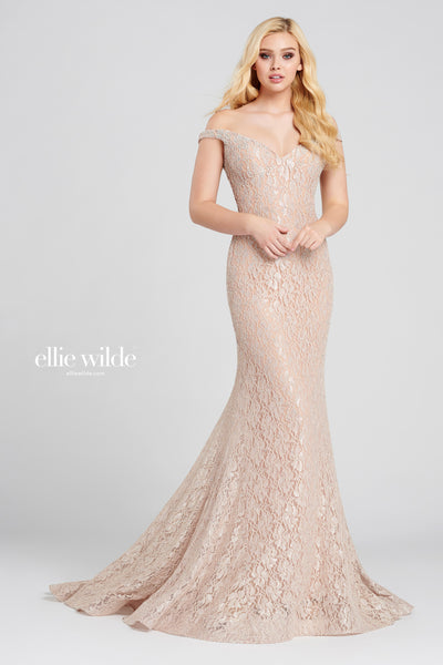 Off-the-shoulder stretch lace fit and flare gown with a sweetheart neckline, natural waist, stone accents throughout, horsehair hem detail and a sweep train.  Prom 2020