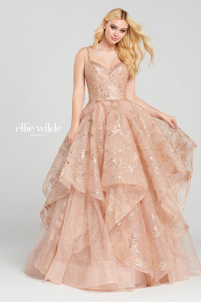 Sleeveless cracked ice ball gown with a v-neck, natural waist, open back, ruffled skirt with a horsehair hem detail.  Prom 2020