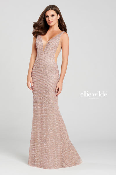 Sleeveless novelty pearl sheath gown with a plunging v-neck, natural waist, sheer side insets, open back and a small train.  Prom 2020