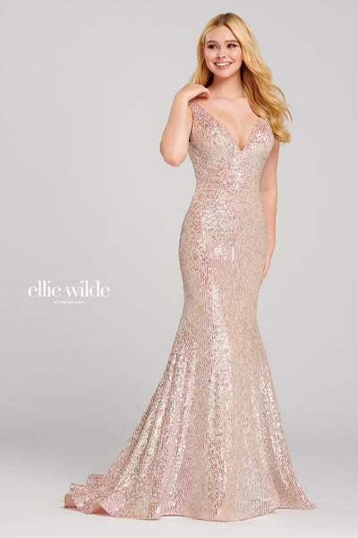 Sleeveless novelty sequin fit and flare gown with a v-neck, natural waist, open back, horsehair hem and a sweep train.  Prom 2020