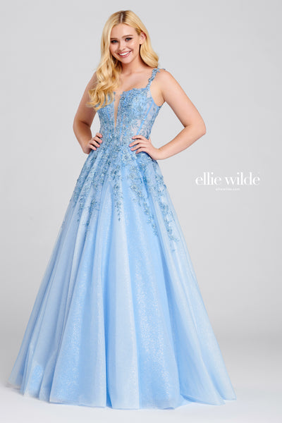 Sleeveless tulle and lace applique a-line gown with a plunging v-neck, sheer bodice, natural waist, scoop back and flowy skirt.  Prom 2020