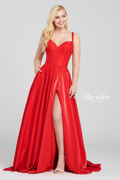 Sleeveless shimmer satin a-line with a sweetheart neckline, natural waist, tuxedo back, high thigh slit and a flowy skirt. Features pockets  Prom 2020