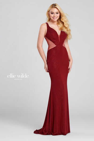 Sleeveless shimmer jersey fit and flare gown with a plunging v-neck, sheer insets at the side with stone accents, natural waist, stone accents throughout gown, open cut out back detail and a sweep train.  Prom 2020