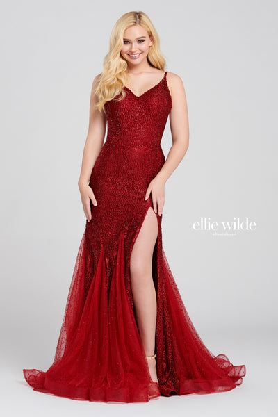 Sleeveless embroidered tulle trumpet gown with a v-neck, natural waist, open back, stone accents throughout, high thigh slit, horsehair hem and full train.  Prom 2020