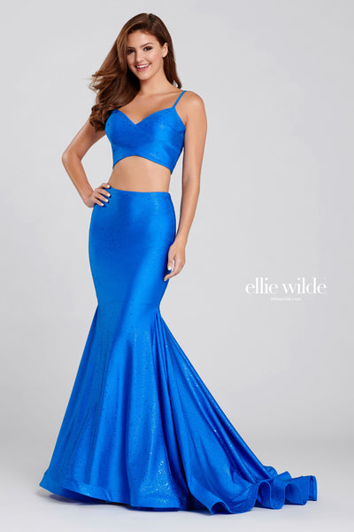 Sleeveless two-piece novelty glitter stretch fit and flare gown with a v-neck, natural waist, horsehair hem and a sweep train.  Prom 2020