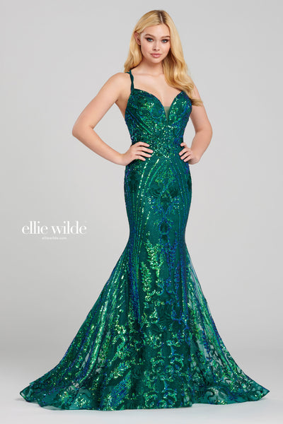 Sleeveless sequin lace fit and flare gown with a plunging v-neck, natural waist, criss cross back, horsehair hem and a sweep train.  Prom 2020