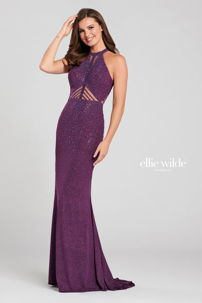 Sleeveless shimmer jersey sheath gown with a high neck, sheer insets at the neckline and natural waist, cut out back, stone accents throughout the gown and a sweep train.  Prom 2020