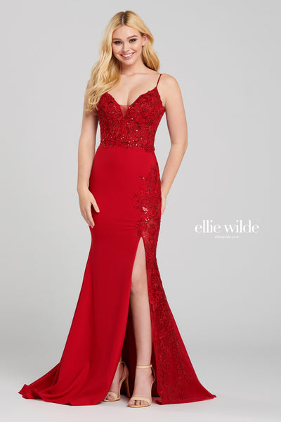 Sleeveless jersey sheath gown with a v-neck, sheer bodice with lace appliques, natural waist, scoop back, high thigh slit with a lace applique accent, stone accents throughout gown and a sweep train.  Prom 2020