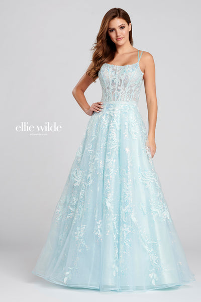 Sleeveless embroidered tulle and sequin a-line gown with a scoop neck, double spaghetti strap, sheer corset bodice, stone accents at the natural waist, lace up back and a flowy skirt. Features pockets. Prom 2020