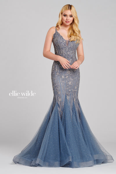 Sleeveless embroidered tulle trumpet gown with a v-neck, natural waist, bandeau back, stone accents throughout gown, horsehair hem and sweep train.  Prom 2020