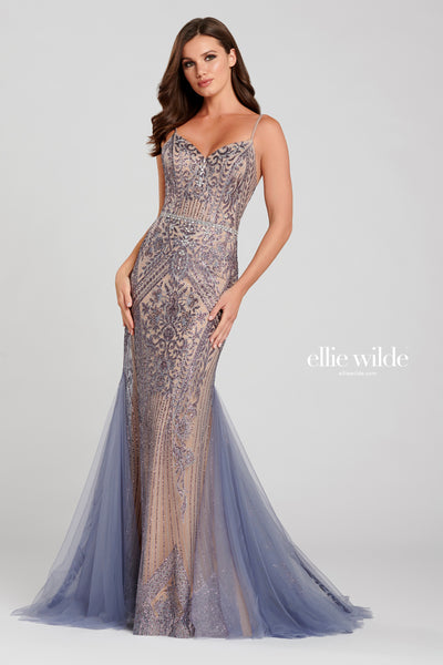 Sleeveless cracked ice fit and flare gown with a v-neck, natural waist with a beaded detail and a tulle train.  Prom 2020