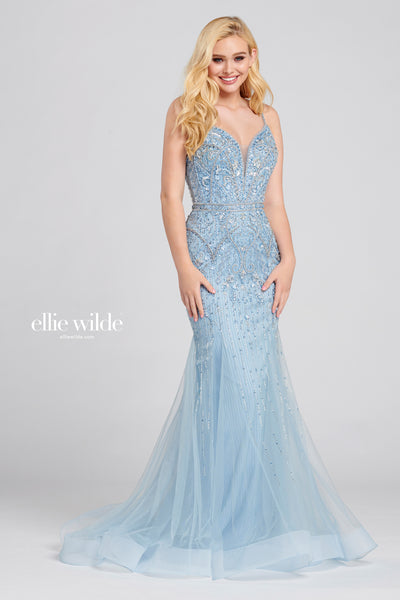 Sleeveless tulle and lace trumpet gown with a plunging v-neck, natural waist, beading throughout the gown, open back, horsehair hem and a sweep train.  Prom 2020