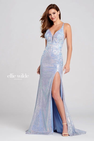 Sleeveless knit sequin fit and flare gown with a plunging v-neck, natural waist, lace up back, stone accents throughout, high thigh slit and a sweep train. Prom 2020