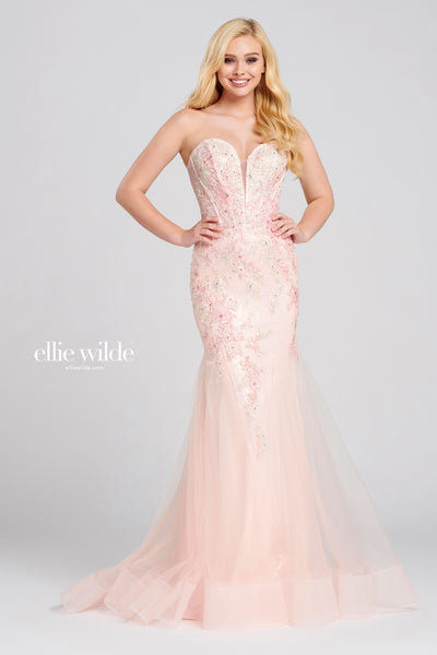 Sleeveless knit sequin trumpet gown with a plunging sweetheart neckline, corset bodice, natural waist, stone accents throughout gown, horsehair hem and a sweep train.  Prom 2020