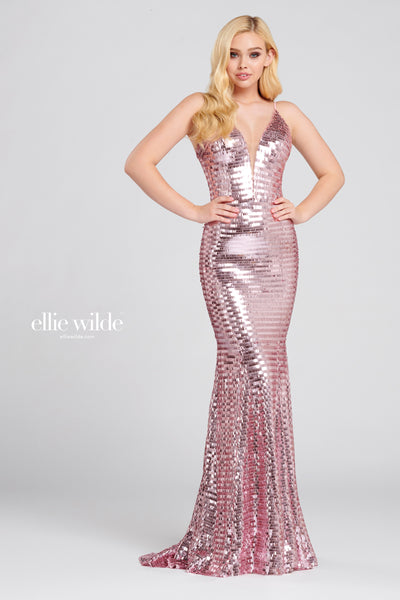 Sleeveless novelty sequin fit and flare gown with a plunging v-neck, natural waist and a sweep train.  Prom 2020