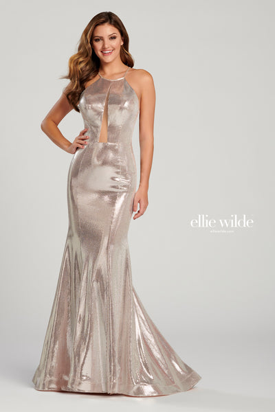 Sleeveless novelty metallic slim fit gown with a halter neck, sheer plunging inset on the bodice, natural waist, cut out back, horsehair hem and a sweep train.  Prom 2020