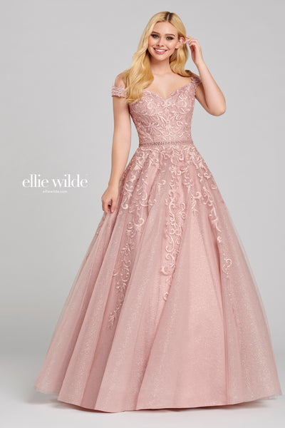 Off-the-shoulder glitter tulle and lace applique gown with a sweetheart neckline, beaded detail at the natural waist and a flowy skirt. Features pockets.  Prom 2020