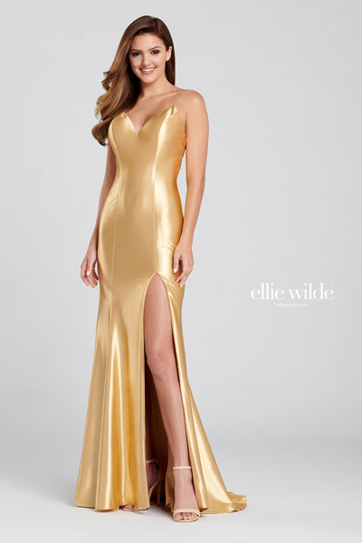 Sleeveless stretch satin sheath gown with a v-neck, criss cross lace up back, thigh slit and a sweep train.  Prom 2020