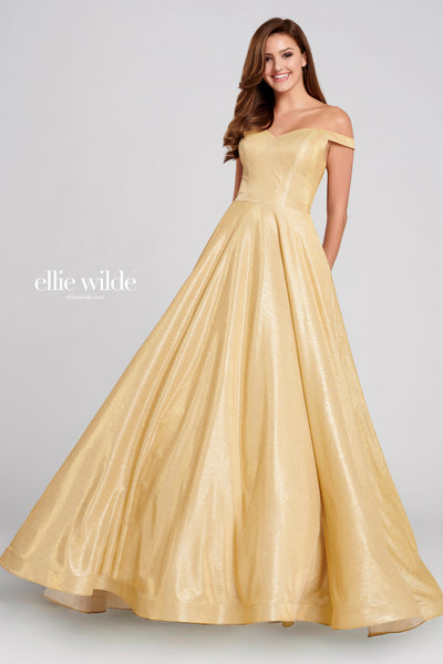 Off-the-shoulder novelty stretch glitter ball gown with a sweetheart neckline, natural waist, tuxedo back, horsehair hem and a sweep train. Features pockets. Matching accessories EW1202T, EW1202B, EW1202C.  Prom 2020