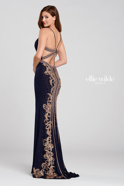 Sleeveless shimmer jersey sheath gown with a plunging v-neck, stone accents on the spaghetti strap and natural waist, strappy criss cross back with stone accents going down the back of the gown and a sweep train.  Prom 2020