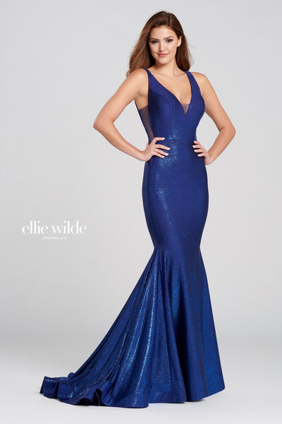 Sleeveless novelty sequin stretch fit and flare gown with a v-neck, sheer side insets, natural waistline, lace up back, horsehair hem and a sweep train Prom 2020