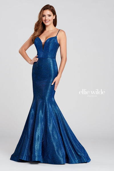 Sleeveless novelty stretch glitter fit and flare gown with a plunging v-neck, natural waist, lace up back, horsehair hem and a sweep train.  Prom 2020